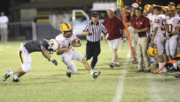 Morgan Academy's John Ross Bone picks up a first down in Friday night's 45-14 loss to Autauga Academy.  The game was Morgan Academy's fifth road game in six weeks. Morgan will play at home this week against Escambia Academy, who is 6-0 on the season.--Doug Horton
