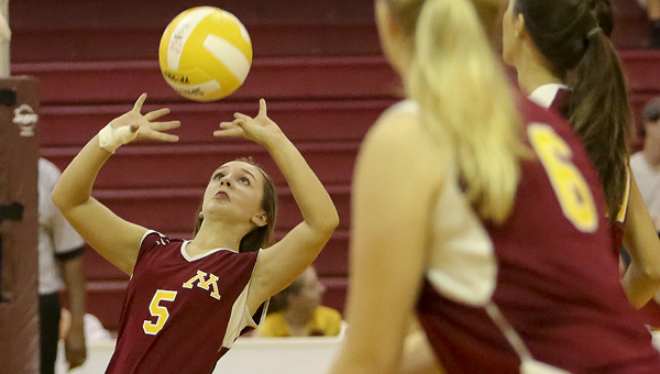 Morgan Academy junior varsity volleyball player Mary Grace Morgan sets up a teammate in a game aerlier this season against Edgewood Academy. The Senators finished second in the JV state tournament this weekend, losing to Kingwood Christian in the championship match.--Doug Horton