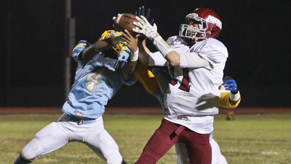 Selma's Devin Gary fights for a pass with a Brookwood player during a game earlier this season. Selma can clinch back-to-back playoff berths win a win Friday over Northridge.--File Photo
