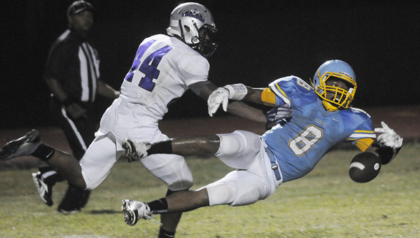 Selma's Lekedrich Rogers attempts to catch a one-handed pass during the first half of Friday night's game against Bessemer City.  The Tigers won the game 28-21 after rallying from a second half deficit. The Saints fell to 5-3 on the season with the loss.--Daniel Evans