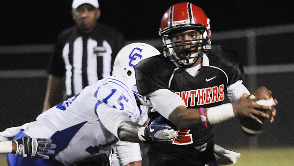 Southside quarterback Khamari Gibbs looks for an open receiver in Friday night's loss to Clarke County.  The Panthers had little success on offense until the second half in the 48-26 defeat.--Daniel Evans