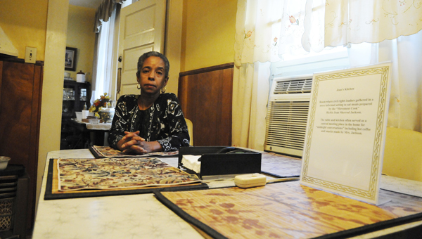 Jawana Jackson sits in her late mother Richie Jean Sherrod Jackson's home Tuesday at the kitchen table where civil rights leaders, such as Martin Luther King Jr., sat to discuss plans for the historical 1965 march from Selma to Montgomery. The home served as the informal headquarters to civil rights leaders during Selma's Voting Rights Movement.