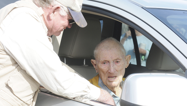 Sam Givhan, left, speaks with his longtime friend Robert Kirk, during Saturday's West Dallas Antique Tractor, Car, Gas Engine and Craft Show. Kirk was presented with a plaque for the 69 years of service he dedicated to Orrville as the owner of R.W. Kirk & Son Inc.--Sarah Robinson