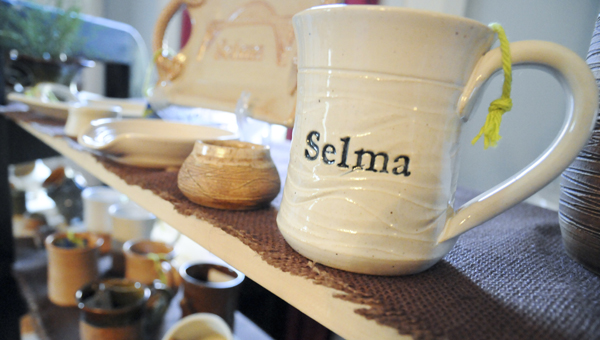 Becky Blaylock's Earthquake Pottery sits on a shelf ready to be purchased Saturday at Sturdivant Hall's fourth annual Artisans' Fair and Big Shop Sale. The sale, which hosted 18 vendors, attracted more than 100 guests. (Sarah Robinson   Times-Journal)