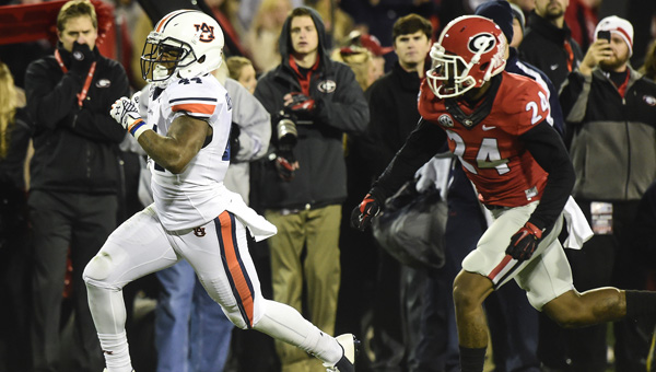 Cameron Artis-Payne runs for Auburn's only score Saturday against Georgia in Athens.