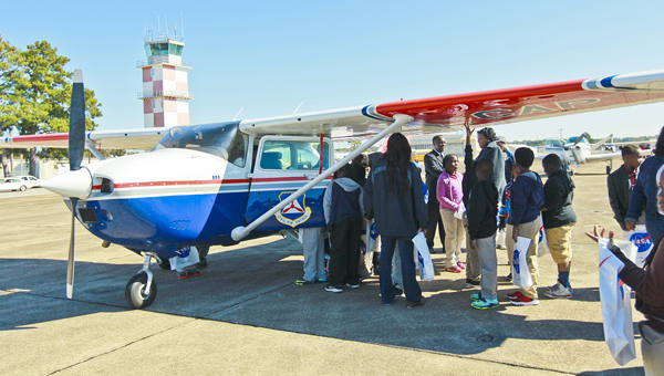 Students get a first-hand look at an airplane Friday during the third annual Aviation Day, which was hosted by Wallace Community College Selma.