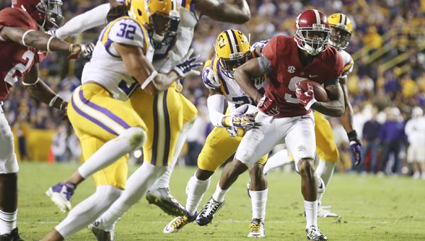 Alabama wide receiver Amari Cooper tries to break a tackle in Saturday's game against LSU.--Kent Gidley