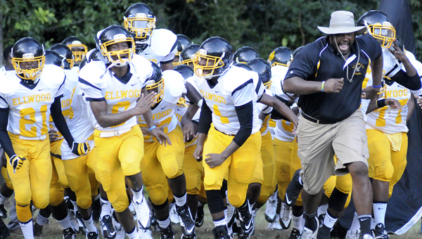 Ellwood Christian runs onto the field for the Eagles' first game this season against Francis Marion, led by head coach Eric Martinear.  The Eagles will travel to Uriah Friday night to take on J.U. Blacksher in the first round of the AHSAA football playoffs. --File Photo