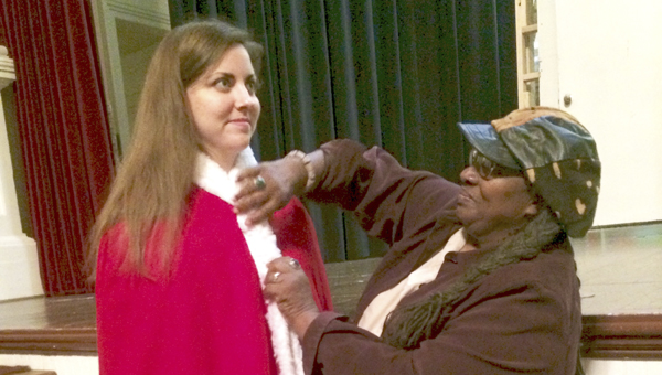 Judson College student Margie Gunter is fitted for her costume by Vassie Wellbeck Browne. Photo by Billie Jean Young.