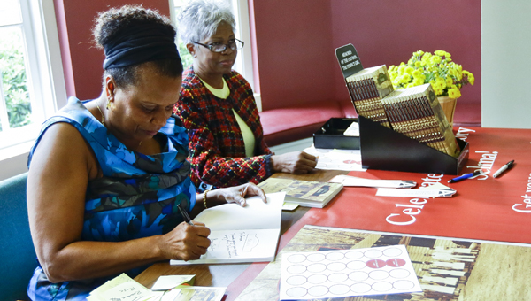 """sign me up: Sharon Jackson signs a copy of her book """"Images of America: Selma."""" She is shown at  the Selma-Dallas County Public Library Thursday with Terry Davis."""
