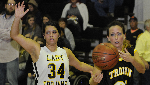 Meadowview Christian basketball player Christina Dabit guards a player from the Lady Trojans alumni team in Friday night's game. --Daniel Evans