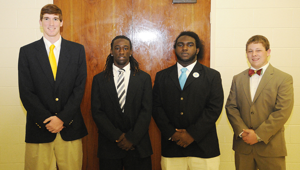 The Selma Quarterback Club awarded four scholarships Monday night. The winners were (left to right) Alan Stockman from Meadowview Christian, DeAnthony Griffin from Keith, Jeremiah Walker from Selma and Bejamin Jones from Morgan Academy.