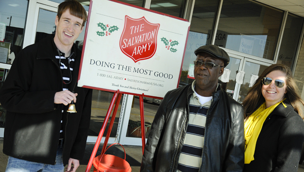 David Lovell, Henry Allen and Maegan Austin participate in the Salvation Army's Red Kettle campaign kickoff Friday.  Allen coordinates bell ringers, while Lovell and Austin are on the local Salvation Army's advisory board.