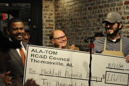 Clay Carmichael (right) with Blackbelt Benefit Group accepts a grant from the ALA-TOM RC&D Council from State Rep. Darrio Melton (left) and Noopie Cosby.