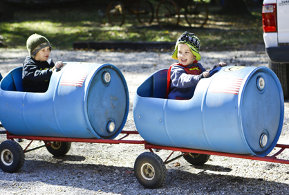 Tyler Phillips enjoys a train ride Saturday at the Kenan's Mill Festival.