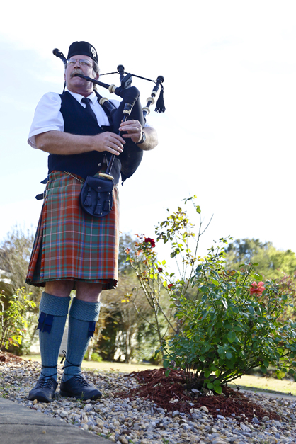 John Nichols plays bagpipes Monday during a Veterans Day program at Vaughan Place Senior Living in Selma.