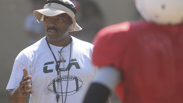 Concordia head coach Stanley Conner talks to his team during a practice earlier this season. Conner is back coaching the Hornets and is feeling much better after some health concerns earlier this season.--File Photo