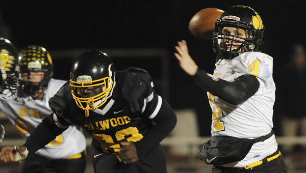 Billingsley's Thomas Nichols, right, throws a pass in front of Ja'Derius Childs in Friday night's game at Memorial Stadium. Nichols and the Bears defeated the the Eagles 72-12 Friday night to advance to the second round of the 1A playoffs--Daniel Evans