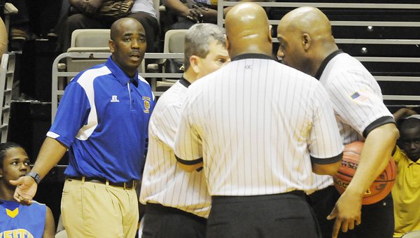 Keith boys basketball coach  Tommy Tisdale waits for a call in a game last season. Tisdale and the Bears lost their season opener to county rival Selma Friday night on a buzzer beater but will look to bounce back Tuesday against R.C. Hatch.--File Photo