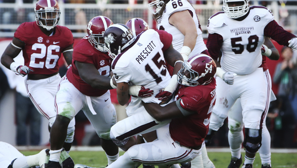 Alabama's Jarran Reed, left, Jonathan Allen, middle, and Dalvin Tomlinson combine to sack Mississippi State quarterback Dak Prescott in Saturday's 25-20 win.