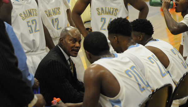 Selma head coach Woodie Jackson talks to his team during a timeout in Friday's 80-70 victory over Francis Marion.--Daniel Evans