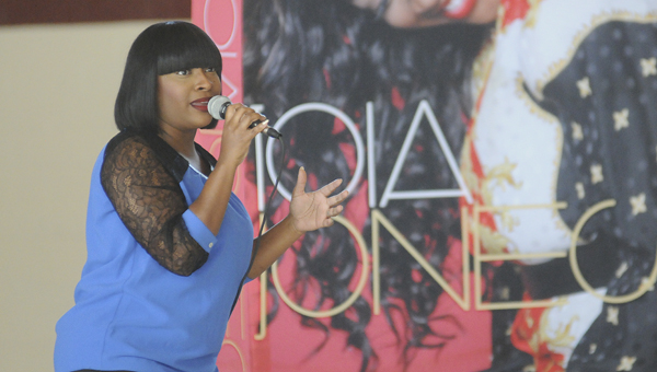 """""""The Voice"""" contestant Toia Jones sings Whitney Houston's """"I Will Always Love You"""" during a visit to R.B. Hudson Middle School on Friday."""