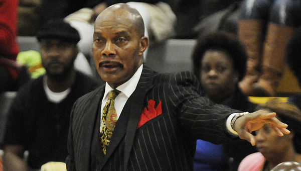 Selma head coach Woodie Jackson coaches in last week's game against Francis Marion. Jackson and the Saints are off to their best start in a number of years after winning their first four games.--Daniel Evans