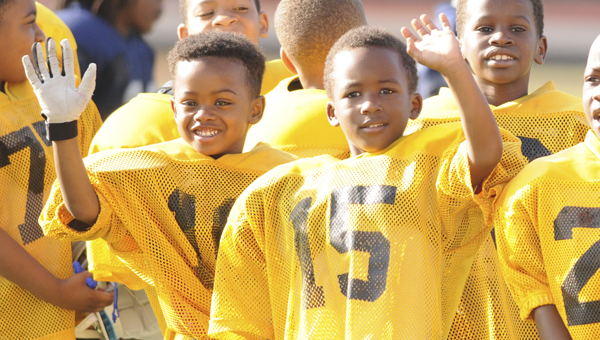 Players for the Bears wave at Memorial Stadium earlier this season. Soon the youth football season will be over, as all three championship games will be played Thursday night.  --File Photo