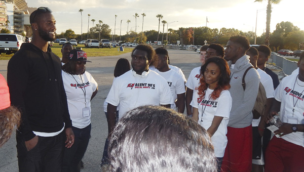 Selma native and NFL star Michael Johnson talks with some of the 44 local students that got to watch him play in Tampa Bay during Thanksgiving weekend. The students had to have a B-average, write an essay and get two reference letters in order to apply for the trip, which was completely paid for by Johnson's Foundation, MJ93.--Submitted Photo