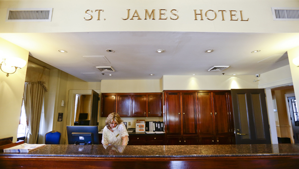 Jennie Wyatt works the front desk at the St. James Hotel on Tuesday afternoon. The city of Selma has taken over day-to-day operations and cancelled its contract with Strand Development.  About half of the hotel's 25-30 employees will be let go, including chef Carlos Brown.