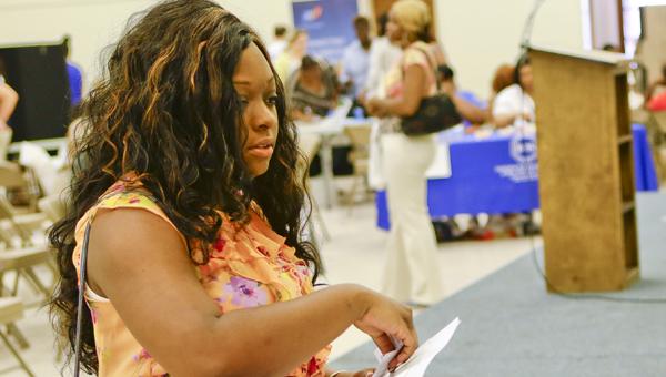 Shemaiah Campbell talks with representatives during Wednesday's job fair at the Carl C. Morgan Convention Center. --Alaina Denean Deshazo