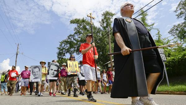 St. Paul's Selma verger Don King leads the Jonathan Daniels pilgrimage Saturday in Hayneville.