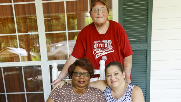Lula Hatcher, owner of Lannie's Barbecue, Stacy Banks and Trea Newsome pose for a photo outside of Hatcher's home Tuesday shortly after it was announced that Lannie's won the Alabama Barbecue Battle competition.