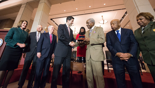 The Rev. Frederick D. Reese is awarded a Congressional Gold Medal on behalf of all foot soldiers by U.S. House Speaker Paul Ryan. Also shown House Minority Leader Nancy Pelosi, Senate Minority Leader Harry Reid, Senate Majority Leader Mitch McConnell, CongresswomanTerri Sewell and Congressman John Lewis, who led the Bloody Sunday march with the Rev. Hosea Williams.