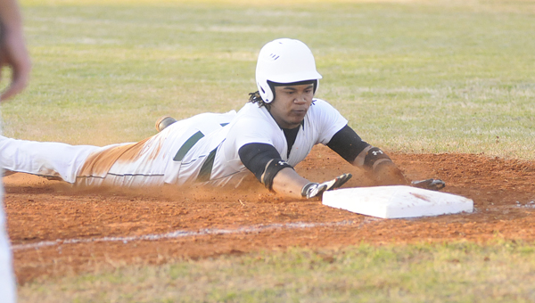 Dallas County's Delando Atchison slides into third base during Friday's game against Francis Marion.  The Hornets defeated the Rams 13-6. — Justin Fedich