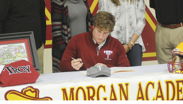 Morgan Academy's J.R. Wood signed his letter of commitment Wednesday at Morgan to play fullback for Troy University next season. —Justin Fedich