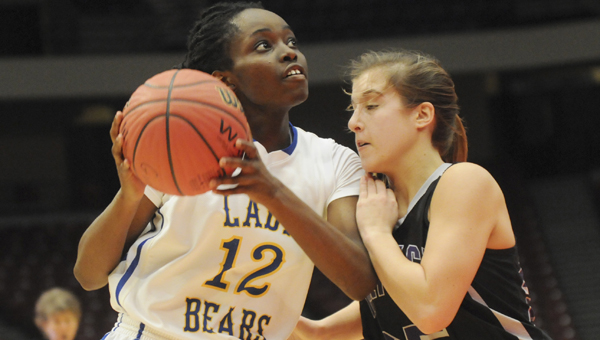 Keith's Harriet Winchester gets ready to shoot during a game last February against Decatur Heritage. The Bears are two wins away from getting back to Birmingham. They play at 3 p.m. Thursday against Notasulga. --Daniel Evans