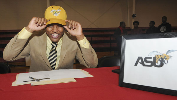 Southside's Khamari Gibbs puts on his Alabama State hat Wednesday at Southside during National Signing Day. Gibbs signed his letter of commitment to play as a preferred walk-on at Alabama State next season. — Daniel Evans