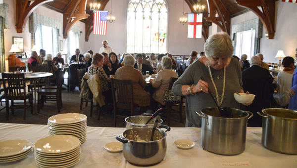 Sandy Greene dishes up a bowl of chicken and sausage gumbo during the Lenten lunch Wednesday at St. Paul's Episcopal Church.