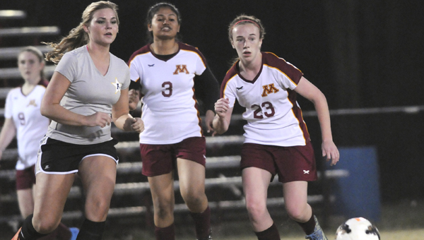 Morgan Academy's  Jordan Harrison, right, and Krishna Patel, middle, chase after a ball during Morgan Academy's home game against Autauga Academy Friday.  Harrison scored the lone goal of the game off a free kick to lead the Senators to a 1-0 victory over the Generals. —Daniel Evans