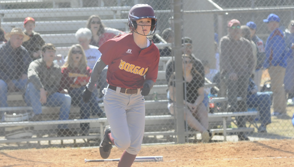 Abigail Lane runs to first base for a single in a game Saturday against Marengo.  — Justin Fedich