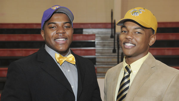 Selma High School's Aderick Moore and Southside's Khamari Gibbs pose for a picture Wednesday after signing letters of intent to play college football. Moore will play football at Tennessee Tech. Moore will be attending Alabama State. --Daniel Evans