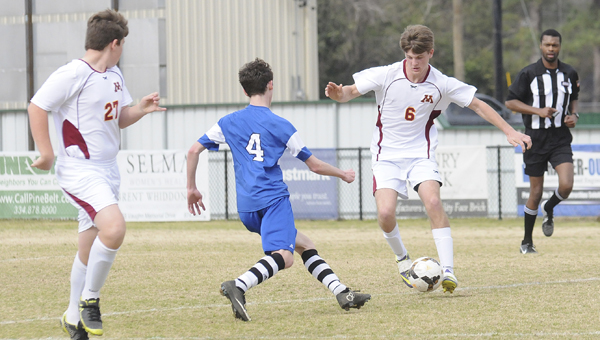 Morgan Academy's Calvin Oslund looks to pass to Jack Stewart during Saturday's win over Kingwood Christian. --Daniel Evans