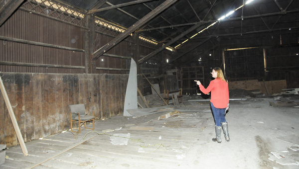 Old Depot Museum director Beth Spivey wants to save the warehouse next to the museum. The city had considered tearing down the building.
