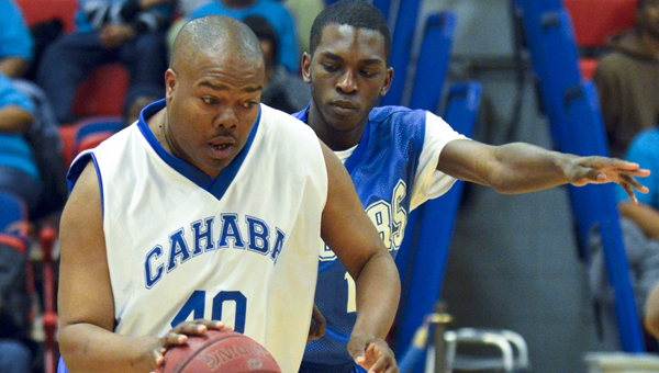 Cahaba Center's Greg Walker (40) dribbles past a defender in the first half against Montgomery TRC Tigers during the Special Olympic Basketball Classic on Friday.