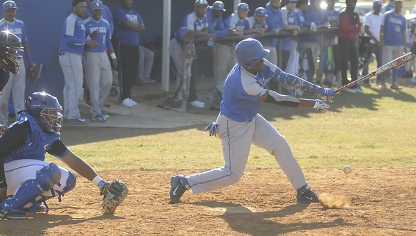 Selma University's Deshun Bolling hits a ground ball as his teammates watch on from the dugout during the Bulldogs' second game in a doubleheader against Rust College.  Selma University won both games by a combined score of 26-3. — Justin Fedich