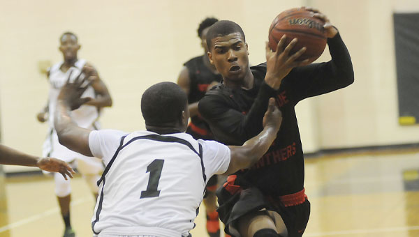 Southside's Kentavius Page attempts to drive around Dallas County's Jaydon Buford during a game between the Panthers and the Hornets Wednesday at Dallas County.  Southside won 63-58 and will face Thomasville Tuesday at 5 p.m. at Monroe County in the first round of the class 4A, area 3 tournament.  Dallas County hosts Ellwood Christian Friday. —Justin Fedich