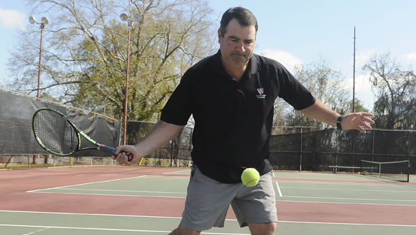 Baxter Stinson hits a tennis ball Wednesday at the city of Selma's tennis courts.  Stinson was named the tennis professional of the year by the USTA's Alabama Awards Committee and will be honored Saturday in Montgomery. --Daniel Evans