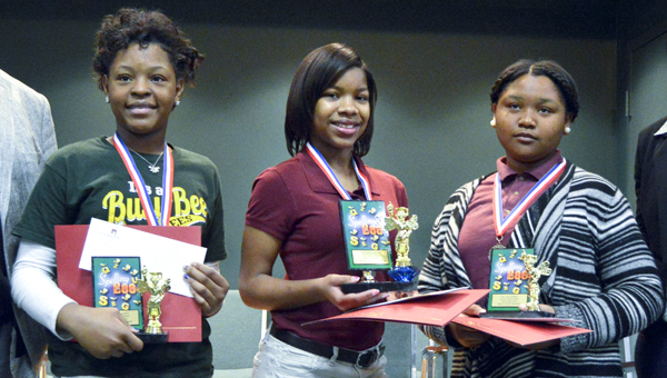 Aniya Mitchell, Jo'Niya Chapman and Jakayla Boone pose for a photo after placing in the countyw spelling bee on Feb. 12.
