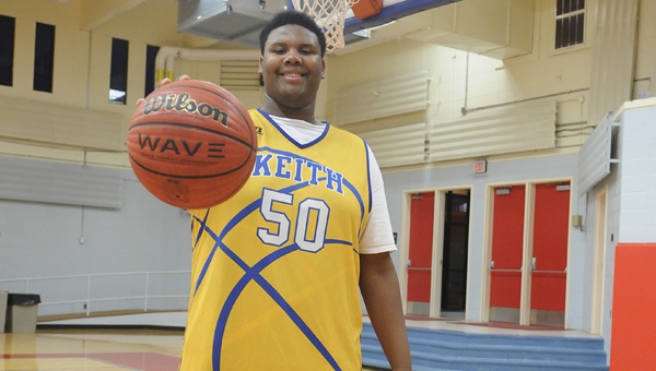 At 6-foot-5 and 310 pounds, Morris Collins is known for his contributions on the football field. But his presence on the basketball court has also been felt. —Daniel Evans